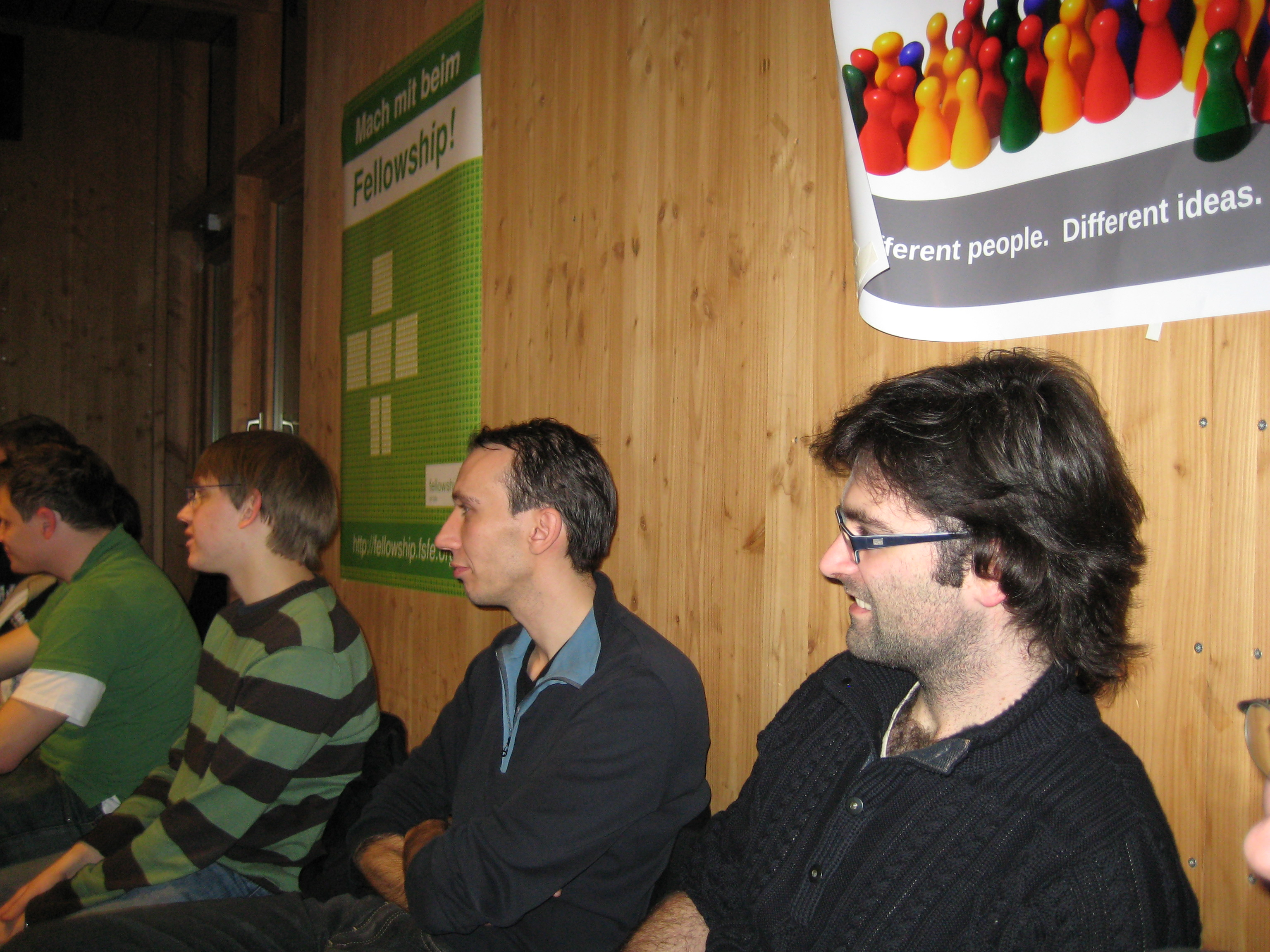 People listen interested to the presentation of KDE4.2